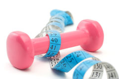 Weights Wrapped Around A Measurement Tape Royalty Free Stock Photography