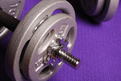Weights on yoga mat Stock Photos