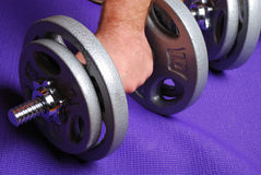 Weights on yoga mat Stock Photo