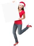 Weihnachten überraschte Frau, die unbelegtes Zeichen anhält stockfotos
