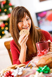 Weihnachten: Bäcker Eating Cookie mit Kaffee Stockbilder