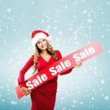 Weihnachten - Frau hält Hände: Untertitel des Brettes im Verkauf stockbilder