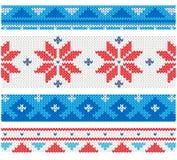 Weihnachten gestrickte Grenzen mit traditionellen Verzierungen Stockfotografie