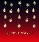 Weihnachten mit Lichtern in Form des Notenschlüssels Stockfoto