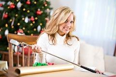 Weihnachten: Nicht sicher, wie man Golfclub einwickelt Stockfotografie