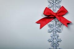 Weihnachten und neue Jahre Schneeflockenhintergrund Stockfotografie