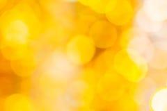 Weihnachtenorange und gelbes bokeh Stockfotografie