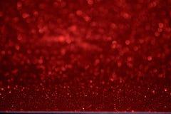 Weihnachtenroter bokeh Hintergrund Das Konzept der Liebe, Valentinsgruß Lizenzfreie Stockfotografie