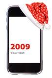 Weihnachtensmartphone Lizenzfreies Stockfoto