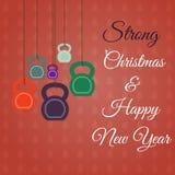 Weihnachts- und des neuen Jahresgrußkarte mit kettlebells Lizenzfreie Stockbilder
