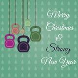 Weihnachts- und des neuen Jahresgrußkarte mit kettlebells stockfotos