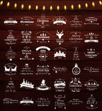 Weihnachts- und des neuen Jahresweinleseaufkleber und -embleme eingestellt Lizenzfreie Stockbilder