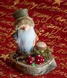 Weihnachts  Wichtel auf Baumscheibe. A beautiful christmas candle Weihnachts  Wichtel auf Baumscheibe Stock Images