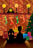 Weihnachtsabend durch den Kamin Stockfotografie