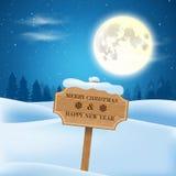 Weihnachtsanzeige auf einem schneebedeckten Gebiet und einem Vollmond Stockfotos