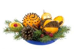 Weihnachtsaufbau mit orange Pomanders Stockfotografie