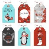 Weihnachtsausweise mit Tieren Vogel, Pinguin Neues Jahr und Weihnachtskarten Stilvolle Tags mit Christus Stockfotografie