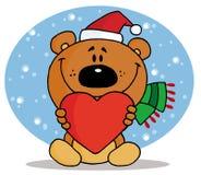 Weihnachtsbär, der ein rotes Inneres anhält Lizenzfreies Stockfoto