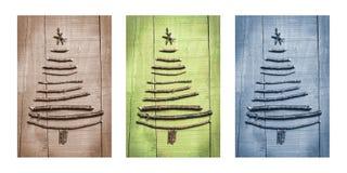 Weihnachtsbäume gemacht von den hölzernen Niederlassungen Triptychon im Braun, im Grün und im Blau Stockfotografie