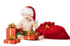 Weihnachtsbaby-Kinder, Kinderanwesende Geschenkbox und Santa Bag Lizenzfreies Stockbild