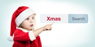 Weihnachtsbaby in Santa Hat mit WWW-Adresszeile Stockfotos