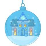 Weihnachtsball mit einem kleinen Haus Stockbilder