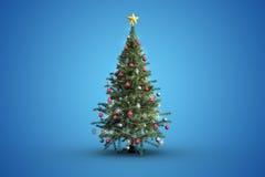 Weihnachtsbaum auf blauem Hintergrund Stockfotografie
