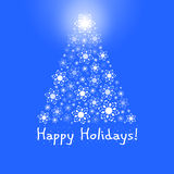Weihnachtsbaum auf blauem Hintergrund Lizenzfreie Stockbilder