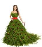 Weihnachtsbaum-Frauen-Kleid, Mode-Modell auf Weiß, Weihnachtsmädchen Lizenzfreies Stockfoto