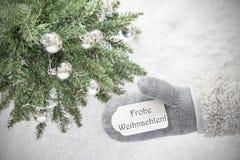 Weihnachtsbaum, Handschuh, Frohe Weihnachten bedeutet frohe Weihnachten, Schneeflocken Lizenzfreie Stockfotos