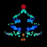 Weihnachtsbaum machte ââof bokeh Leuchten Lizenzfreies Stockbild