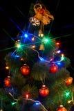 Weihnachtsbaum mit Blinken und Glocke. Lizenzfreie Stockfotos
