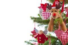 Weihnachtsbaum mit roter und weißer hängender Dekoration mit Elchen an Lizenzfreies Stockbild