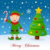 Weihnachtsbaum u. grüne Elfe auf dem Schnee Stockbild