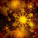 Weihnachtsbaum und brennende Schneeflocken Stockbilder