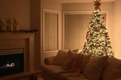Weihnachtsbaum-warmes Haus Lizenzfreies Stockbild