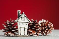 Weihnachtsbaum-warmes Haus Lizenzfreies Stockfoto