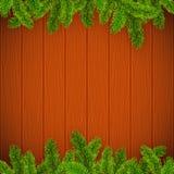 Weihnachtsbaumaste auf hölzernem Hintergrund Lizenzfreies Stockfoto