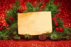 Weihnachtsbaumaste mit leerer Anmerkung Lizenzfreies Stockfoto