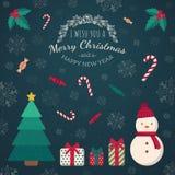 Weihnachtsbaumspielwaren und Grußtext Stockfotos