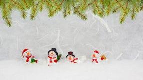 Weihnachtsbeleg mit Schneemännern Lizenzfreie Stockfotografie
