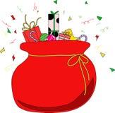 Weihnachtsbeutel mit Geschenken Stockfotos