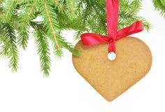 Weihnachtsbiskuit auf Weiß Stockbild
