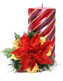 Weihnachtsblume mit Kerze Stockbild