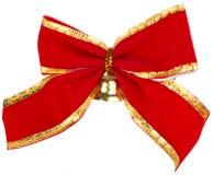Weihnachtsbogen mit einer goldenen Glocke Stockbild