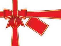 Weihnachtsbogen und -farbbänder mit unbelegter Geschenkkarte Stockfotografie