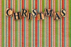 Weihnachtsbriefe auf gestreiftem Hintergrund Stockbilder