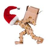 Weihnachtscharakter, der einen großen Kasten trägt Lizenzfreies Stockbild