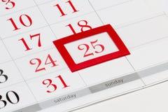 Weihnachtsdatum am Kalender Lizenzfreie Stockfotos
