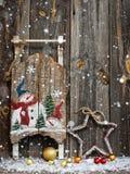Weihnachtsdekoration über hölzernem Hintergrund Stockbilder